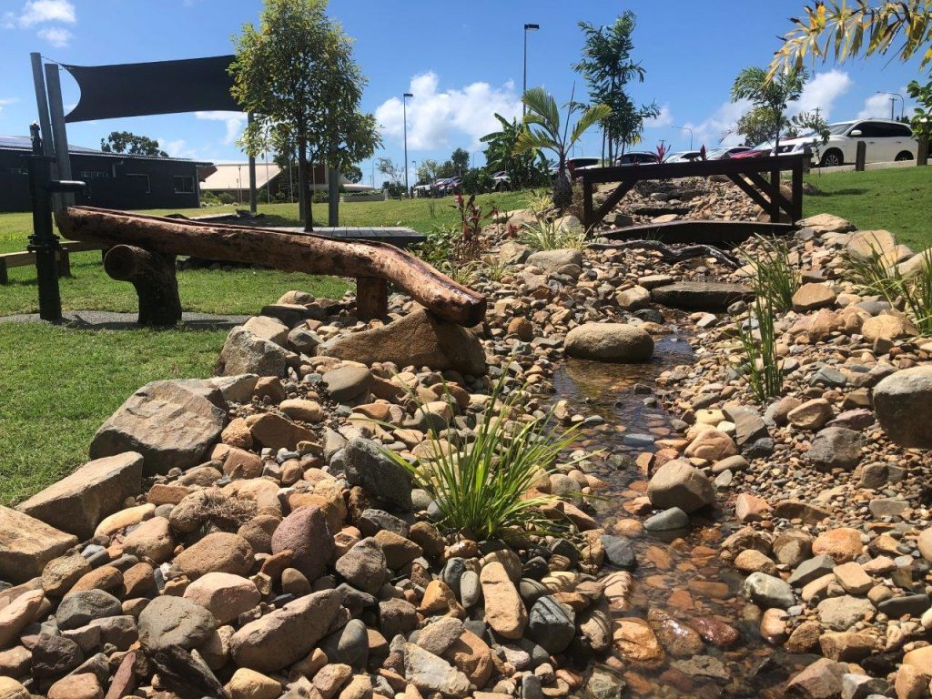 recirculating creek school learning spaces by North Queensland Landscaping Team PW Landscapes