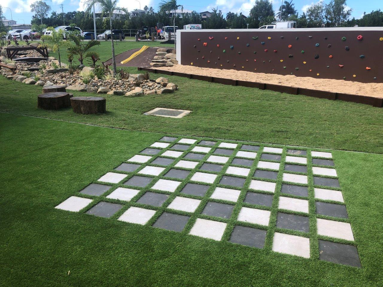 life size chess school learning spaces by North Queensland Landscaping Team PW Landscapes